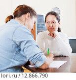 Купить «Mature woman answer questions», фото № 12866790, снято 16 июня 2019 г. (c) Яков Филимонов / Фотобанк Лори