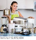 Girl with kitchen appliances at home. Стоковое фото, фотограф Яков Филимонов / Фотобанк Лори