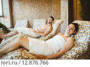 Купить «Man and woman lying down», фото № 12876766, снято 17 июля 2015 г. (c) Wavebreak Media / Фотобанк Лори