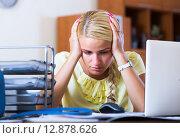 Tired woman sitting at desk, фото № 12878626, снято 24 марта 2017 г. (c) Яков Филимонов / Фотобанк Лори