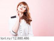 Купить «Портрет красивой девушки на розовом фоне», фото № 12880486, снято 19 ноября 2018 г. (c) Efanov Aleksey / Фотобанк Лори