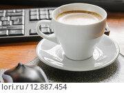 Купить «Кофе на работе», фото № 12887454, снято 9 октября 2015 г. (c) Алёшина Оксана / Фотобанк Лори
