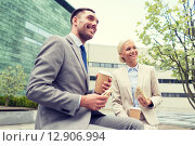 smiling businessmen with paper cups outdoors. Стоковое фото, фотограф Syda Productions / Фотобанк Лори
