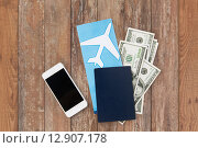 Купить «air ticket, money, smartphone and passport», фото № 12907178, снято 30 июля 2015 г. (c) Syda Productions / Фотобанк Лори