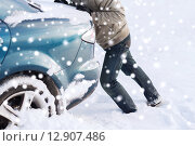 Купить «closeup of man pushing car stuck in snow», фото № 12907486, снято 16 января 2014 г. (c) Syda Productions / Фотобанк Лори