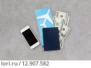 Купить «air ticket, money, smartphone and passport», фото № 12907582, снято 30 июля 2015 г. (c) Syda Productions / Фотобанк Лори