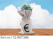 Купить «close up of euro paper money in bag on table», фото № 12907586, снято 30 июля 2015 г. (c) Syda Productions / Фотобанк Лори