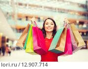 Купить «smiling woman with colorful shopping bags», фото № 12907714, снято 22 сентября 2013 г. (c) Syda Productions / Фотобанк Лори