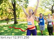 Купить «happy young female runner winning on race finish», фото № 12911250, снято 16 августа 2015 г. (c) Syda Productions / Фотобанк Лори