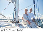 Купить «senior couple hugging on sail boat or yacht in sea», фото № 12911254, снято 18 августа 2015 г. (c) Syda Productions / Фотобанк Лори