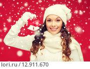 Купить «smiling woman in mittens and hat with jingle bells», фото № 12911670, снято 22 сентября 2013 г. (c) Syda Productions / Фотобанк Лори