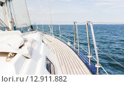 Купить «close up of sailboat or sailing yacht deck and sea», фото № 12911882, снято 13 июля 2014 г. (c) Syda Productions / Фотобанк Лори