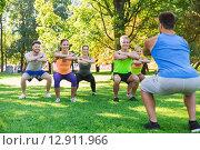 Купить «group of friends or sportsmen exercising outdoors», фото № 12911966, снято 16 августа 2015 г. (c) Syda Productions / Фотобанк Лори