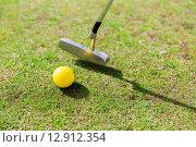 Купить «close up of club and ball near hole on golf field», фото № 12912354, снято 30 августа 2015 г. (c) Syda Productions / Фотобанк Лори