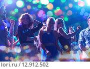 Купить «group of happy friends dancing in night club», фото № 12912502, снято 20 октября 2014 г. (c) Syda Productions / Фотобанк Лори