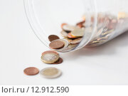 Купить «close up of euro coins in open glass jar on table», фото № 12912590, снято 30 июля 2015 г. (c) Syda Productions / Фотобанк Лори