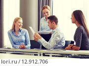 Купить «smiling business people with papers in office», фото № 12912706, снято 25 октября 2014 г. (c) Syda Productions / Фотобанк Лори