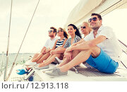 Купить «smiling friends sitting on yacht deck», фото № 12913118, снято 13 июля 2014 г. (c) Syda Productions / Фотобанк Лори