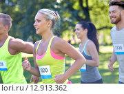 Купить «happy young sportsmen racing wit badge numbers», фото № 12913362, снято 16 августа 2015 г. (c) Syda Productions / Фотобанк Лори