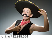 Купить «Person wearing sombrero hat in funny concept», фото № 12918554, снято 3 июня 2014 г. (c) Elnur / Фотобанк Лори