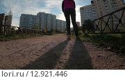 Купить «Девушка едет на самокате по грунтовой дорожке по двору спального микрорайона, вид сзади и снизу», видеоролик № 12921446, снято 18 октября 2015 г. (c) Кекяляйнен Андрей / Фотобанк Лори