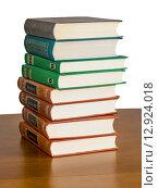 Купить «Стопка книг на столе», фото № 12924018, снято 12 июля 2015 г. (c) Валерий Апальков / Фотобанк Лори