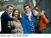 Купить «Group of friends shooting mutual portrait on cell phone», фото № 12926034, снято 14 августа 2018 г. (c) Яков Филимонов / Фотобанк Лори