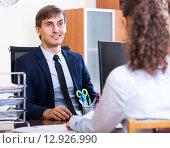 Купить «Friendly hr manager inreviewing competitor», фото № 12926990, снято 1 апреля 2020 г. (c) Яков Филимонов / Фотобанк Лори