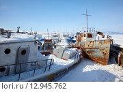Купить «Old frozen ships in the port of Olkhon island on siberian lake Baikal», фото № 12945762, снято 14 марта 2013 г. (c) Serg Zastavkin / Фотобанк Лори
