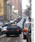 Купить «Пробка в переулке Сивцев Вражек в Москве», эксклюзивное фото № 12948754, снято 18 февраля 2010 г. (c) lana1501 / Фотобанк Лори