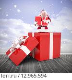 Купить «Composite image of santa standing in large gift», фото № 12965594, снято 18 июня 2019 г. (c) Wavebreak Media / Фотобанк Лори