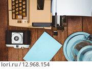 Купить «View of an old typewriter and camera», фото № 12968154, снято 18 мая 2015 г. (c) Wavebreak Media / Фотобанк Лори