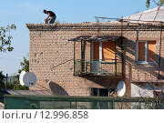 Купить «Восстановление жилья  в  ЛНР», фото № 12996858, снято 8 августа 2015 г. (c) Aleksander Kaasik / Фотобанк Лори