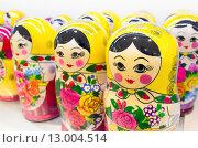 Купить «Русские матрешки», фото № 13004514, снято 30 октября 2015 г. (c) EugeneSergeev / Фотобанк Лори