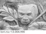 Купить «Фрагмент барельефа на бетонном заборе. Таиланд», фото № 13004990, снято 20 февраля 2015 г. (c) Александр Романов / Фотобанк Лори