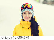 Купить «happy young woman in ski goggles outdoors», фото № 13006670, снято 7 февраля 2015 г. (c) Syda Productions / Фотобанк Лори