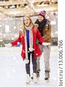 Купить «happy couple on skating rink», фото № 13006766, снято 26 ноября 2014 г. (c) Syda Productions / Фотобанк Лори