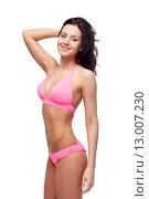 Купить «happy young woman in pink bikini swimsuit», фото № 13007230, снято 14 апреля 2015 г. (c) Syda Productions / Фотобанк Лори