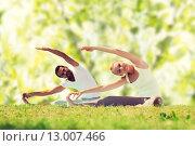 Купить «happy couple stretching and doing yoga exercises», фото № 13007466, снято 6 августа 2014 г. (c) Syda Productions / Фотобанк Лори