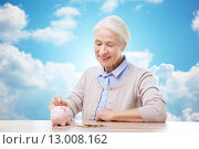 Купить «senior woman putting money to piggy bank», фото № 13008162, снято 10 июля 2015 г. (c) Syda Productions / Фотобанк Лори