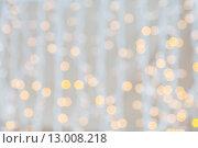 Купить «blurred glden lights background», фото № 13008218, снято 10 сентября 2014 г. (c) Syda Productions / Фотобанк Лори