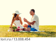 Купить «smiling couple with small red gift box on picnic», фото № 13008454, снято 23 июля 2014 г. (c) Syda Productions / Фотобанк Лори