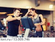 Купить «woman with trainer exercising on stepper in gym», фото № 13009746, снято 30 ноября 2014 г. (c) Syda Productions / Фотобанк Лори