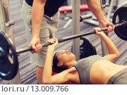 Купить «man and woman with barbell flexing muscles in gym», фото № 13009766, снято 30 ноября 2014 г. (c) Syda Productions / Фотобанк Лори