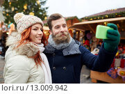 Купить «couple taking selfie with smartphone in old town», фото № 13009942, снято 11 декабря 2014 г. (c) Syda Productions / Фотобанк Лори