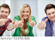 Купить «group of happy students showing thumbs up», фото № 13010426, снято 16 июня 2013 г. (c) Syda Productions / Фотобанк Лори