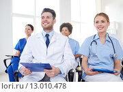 Купить «group of happy doctors on seminar at hospital», фото № 13010478, снято 14 марта 2015 г. (c) Syda Productions / Фотобанк Лори