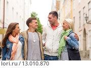 Купить «group of smiling friends walking in the city», фото № 13010870, снято 14 июня 2014 г. (c) Syda Productions / Фотобанк Лори