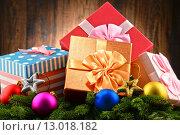 Купить «Colorful gift boxes and christmas tree», фото № 13018182, снято 4 апреля 2020 г. (c) PantherMedia / Фотобанк Лори