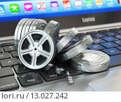 Купить «Video or movie online internet concept. Film reels on laptop keyboard.», фото № 13027242, снято 22 августа 2019 г. (c) Maksym Yemelyanov / Фотобанк Лори